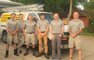 PICTURED HERE ARE 6 PROFESSIONAL BAT CONTROL EXPERTS AND ATTIC RESTORATION SPECIALISTS IN OHIO - HIRE THE BEST BAT CONTROL COMPANY IN OHIO -Pictured Here Are 6 Professional Bat Control Experts And Attic Restoration Specialists In Ohio - This humane bat removal company picture was taken in Cleveland, Ohio on May 26, 2021. Shown in the picture (left to right) are Kyle Fortune, Tyler Phillips, Alex Svensen, Nathan Lang, Mike Cottom Jr. and Jason Neitenbach. CRW is a local (Ohio only) bat control service (Ohio only) that does not exterminate bats or use live traps to catch bats. Rather, bats are safely removed from homes and buildings in Ohio using multiple bat exclusion processes, one-way bat doors (bat valves), bat exclusion devices, funnels, netting and tubes. The 6 men pictured above certainly know how to get rid of bats in houses. First, they identify all the areas where bats get in. Then they remove unwanted bats from buildings by placing exclusion devices over the main bat entrance and by sealing all the other roof gaps and soffit holes. This means that the roof, eaves and attic are sealed except for primary exits which are outfitted with one-way bat doors which allow bats to exit but prevent re-entry. Costs to hire a bat removal specialist in Ohio start at $239. Bat exclusion costs in Ohio start at $1,495. Some pest control companies and exterminators in Ohio, such as Terminix and Orkin offer bat removal services but they these bat removal companies specialize in controlling rodents and insects and don't have the experience and range of equipment required that the Cottom's Wildlife Removal company possesses.